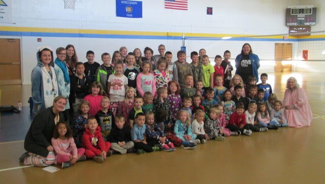 Students at Trinity Lutheran School, Menasha, recently celebrated Lutheran Schools Week. Students participated in dress-up events such as pajama day, crazy day, hat and sock day and school colors day. They are pictured here on pajama day.