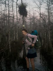 """Gretchen Matt, also known as """"Dirty Bowl,"""" turns around to adjust her pack while wading through the swamps of Big Cypress National Preserve as she begins her 1,100-mile hike on the Florida Trail on Wednesday, Jan. 25, 2017. The Florida Trail is one of 11 National Scenic Trails."""
