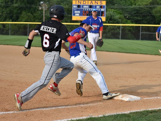 Colton Zeigler beats Waynesboro's Jarrett Biesecker to first base during Game 3 of the Franklin County American Legion championship on Tuesday, July 11 in Waynesboro. Waynesboro led 4-1 when a lightning delay eventually called the game.