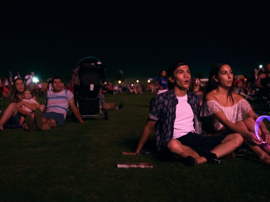 Ian Navarro and Sabrina Flores watch fireworks go off