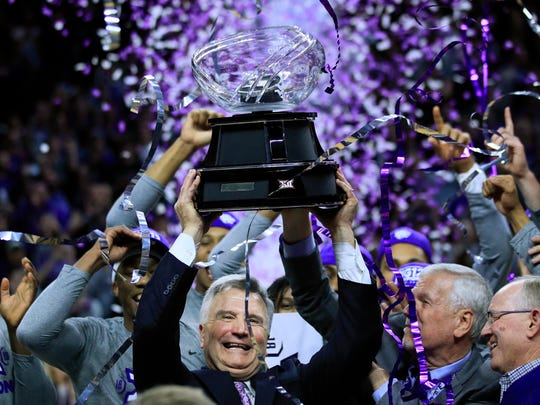 Milwaukee Bruce Weber hoists the Big 12 trophy after Kansas State beat Oklahoma on Saturday.