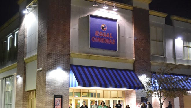 Moviegoers leave the Regal Cinemas multiplex at the Cape Cod Mall in Hyannis. The company announced Monday that it is temporarily suspending operations of its theaters nationwide, including in Hyannis and Mashpee