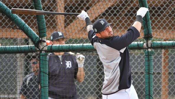 Tigers' Nick Castellanos watches a hit while he takes