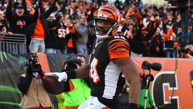 Cincinnati Bengals tight end Jermaine Gresham (84) reacts after catching a touchdown pass against the Pittsburgh Steelers during the first half at Paul Brown Stadium on Dec. 7, 2014.