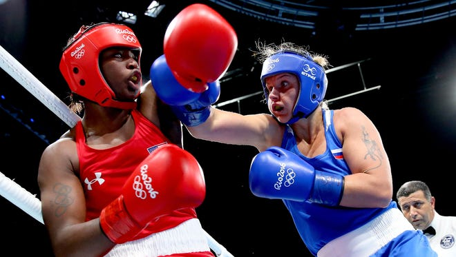 Claressa Shields of the United States and Yaroslava Yakushina of Russia exchange blows during the Women's Middleweight Quarterfinal on Day 12 of the Rio 2016 Olympic Games at Riocentro - Pavilion 6 on August 17, 2016 in Rio de Janeiro, Brazil.