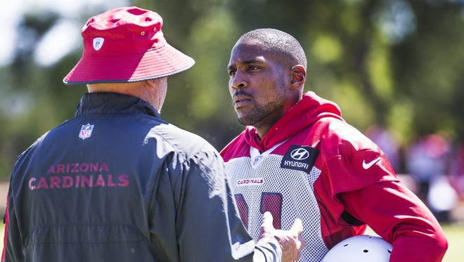 Arizona Cardinals Head Coach Bruce Arians speaks with cornerback Patrick Peterson on the sideline during practice at the Tempe training facility, Wednesday, September 27, 2017.