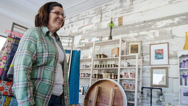 2thirty5 owner Dawn Neagos talks about renovating the interior of her new store Sunday, Oct. 23, in Marine City.
