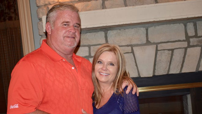 Shawn Fennell celebrates with his wife, Vicki at their Gallatin home after winning the at-large city council race Tuesday.