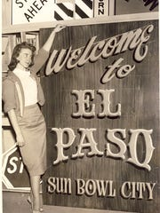 "A photo from April 1960: ""Miss Sue Hogue, secretary to Traffic Engineer Joe Nadon, displays one of the proposed welcome signs slated to be placed at entrances to the city."""