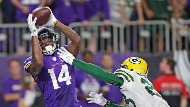 Green Bay Packers cornerback Damarious Randall (23) gives up a touchdown catch to wide receiver Stefon Diggs (14) against the Minnesota Vikings at U.S. Bank Stadium.