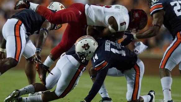 Auburn defensive back Stephen Roberts (14) tackles