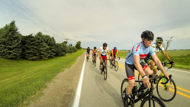 Cyclists pedal out of Newton on Day 5 of the RAGBRAI Pre-Ride Route Inspection on Thursday.  Zach Boyden-Holmes/The Register Riders roll out of Newton on day five of the 2018 RAGBRAI Pre-Ride Route Inspection Thursday, June 7, 2018.