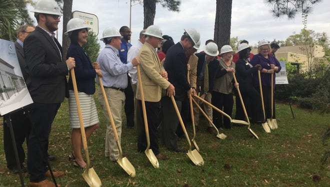 Envision Credit Union board members and business leaders came out for Tuesday's ground breaking ceremony for a $3 million financial center.