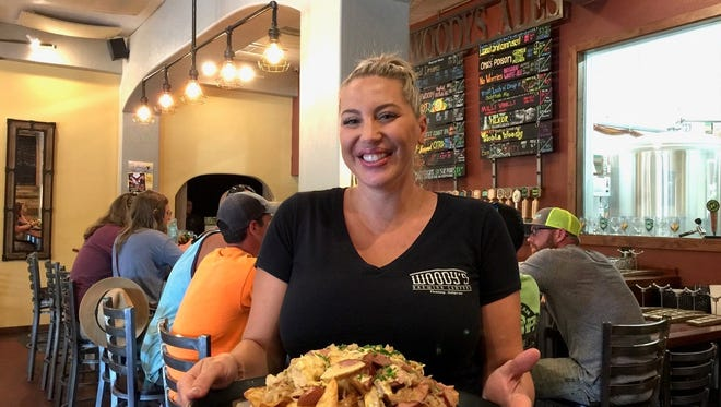 Server Jessica Vance with a big order of Polish Nachos at Woody's Brewing