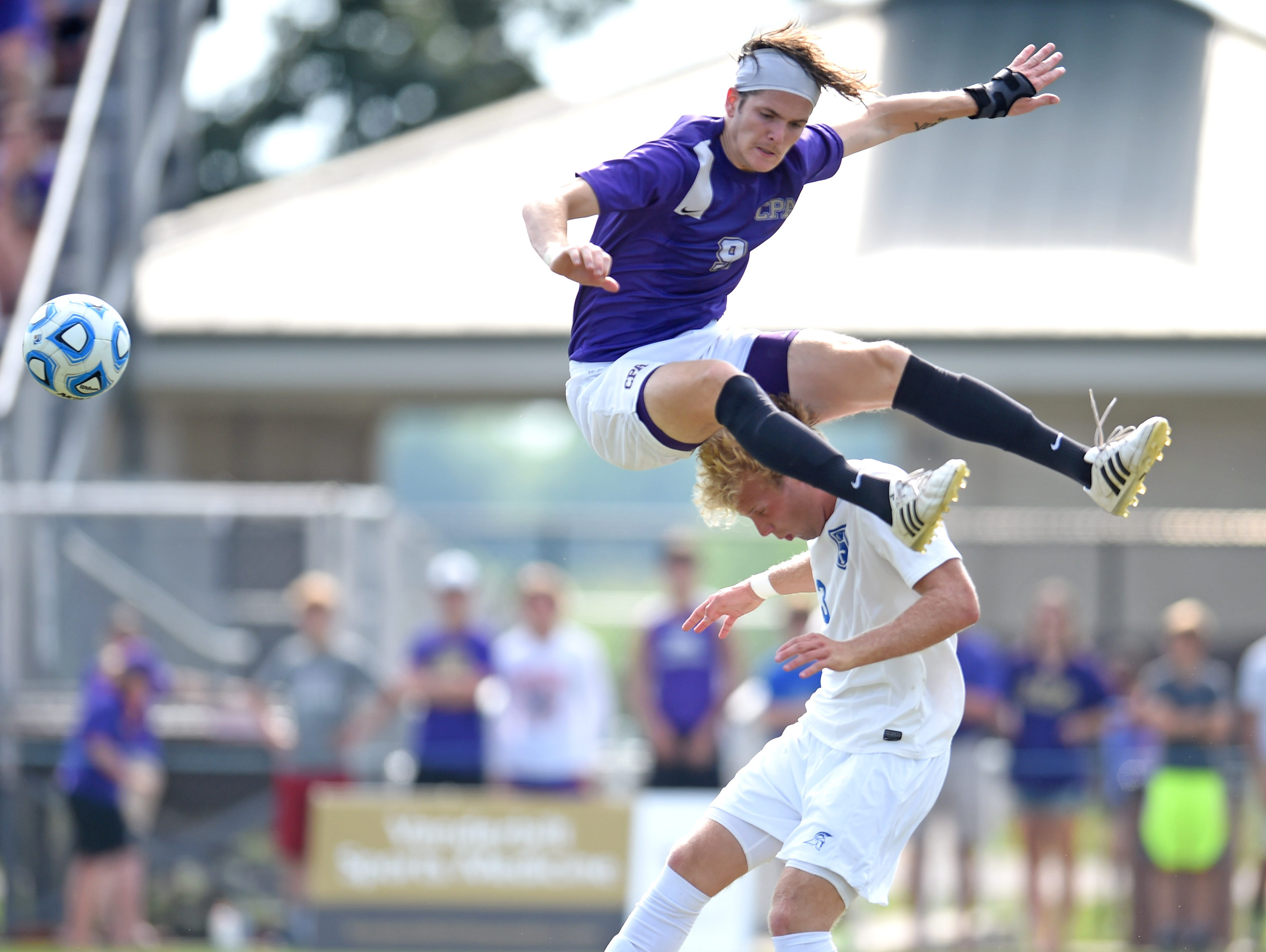CPA's Price Purdue (9) leaps over CAK's Matt Zaczyk (23) while trying to head the ball in a Class A-AA state championship soccer game at Richard Siegel Soccer Complex in Murfreesboro during Spring Fling on Friday, May 27, 2016.