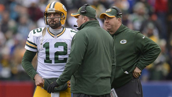 Green Bay Packers quarterback Aaron Rodgers talks with head coach Mike McCarthy during Sunday's game against the Buffalo Bills at Ralph Wilson Stadium in Orchard Park, N.Y. Evan Siegle/P-G Media