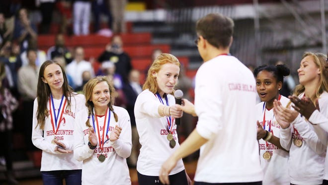 Coach Tim Holman celebrates with team members Kendall Eatherly, left to right, Jordan Grants, Emma Kuntz, Mye' cia Bright,  and Taylor Boggess during a pep rally celebrating their recent state championship win.November 9, 2016