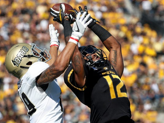 Missouri wide receiver Johnathon Johnson, right, leaps to catch a 50-yard pass as Idaho defensive back Sedrick Thomas defends during the first half of an NCAA college football game Saturday, Oct. 21, 2017, in Columbia, Mo. (AP Photo/Jeff Roberson)