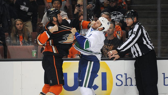 Anaheim Ducks defenseman Clayton Stoner (3) fights against Vancouver Canucks right wing Brandon Prust (9) during the first period at Honda Center.