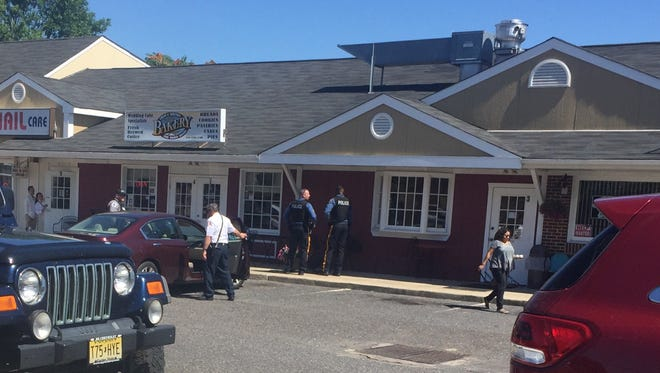 Vineland police and firefighters investigate a crash Wednesday where a car ran into the Crust'N'Krumbs Bakery at Main and Magnolia roads in Vineland.
