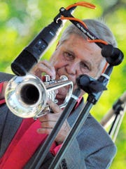 Band founder and lead trumpet Craig Strain of Farmington Hills was in tune at the opening concert.