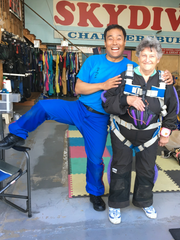 Judy Helfrick, left, with skydiving instructor Chul