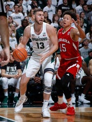 Michigan State's Ben Carter, left, maneuvers against