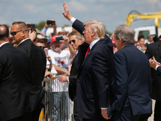 President Trump waves to supporters at the Springfield-Branson Airport on Wednesday, August 30, 2017.