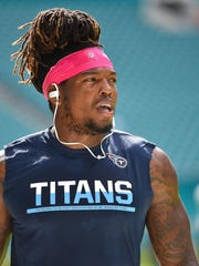 Titans running back Derrick Henry warms up before the