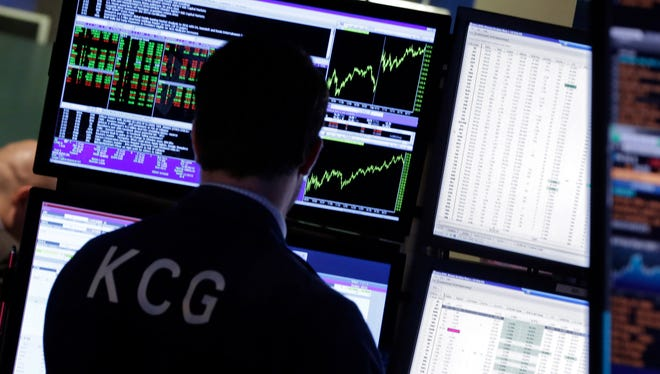A specialist works at his post on the floor of the New York Stock Exchange.