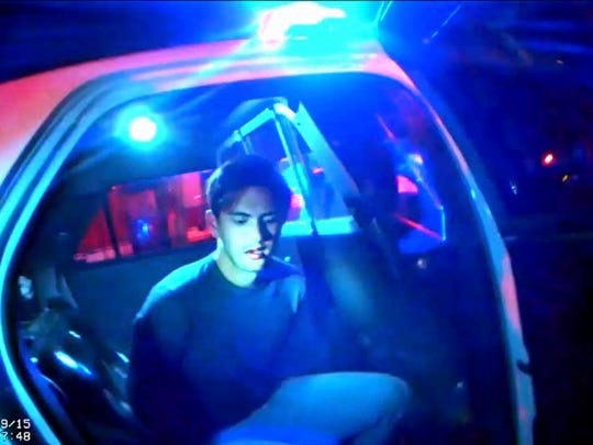 Steven Jones in a patrol car shortly after his arrest