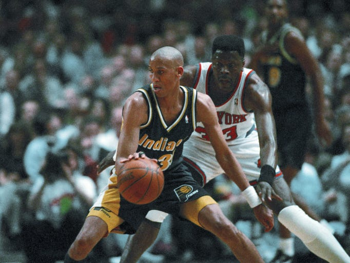 Indiana Pacers guard Reggie Miller, left, handles the ball as he is guarded by New York Knicks center Patrick Ewing during their Eastern Conference semifinal game in New York's Madison Square Garden, Tuesday, May 9, 1995. (AP Photo/Ron Frehm)