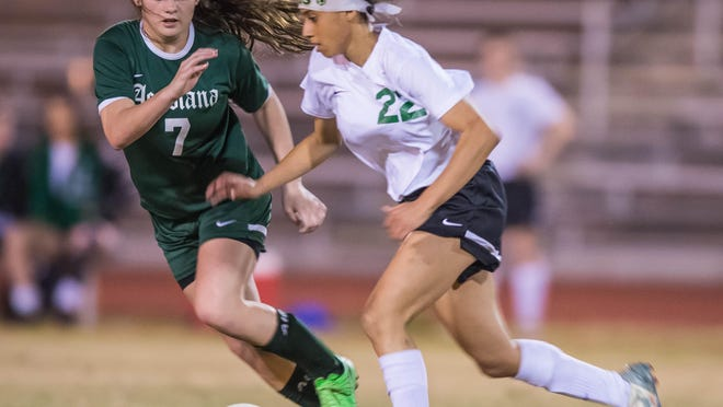 One of the best battles through the game was Lafayette High's offensive star Arieal Alexander (22) against Acadiana's defensive stalwart Sarah Matte (7) during the Lady Rams' 2-1 win Monday at Mighty Lions Stadium.