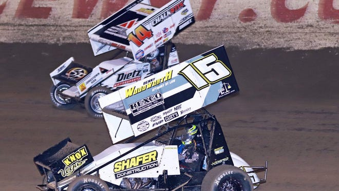 Bobby Mincer (15) of Burlington races against eventual winner Parker Price-Miller during a World of Outlaws show July 3 at 34 Raceway.