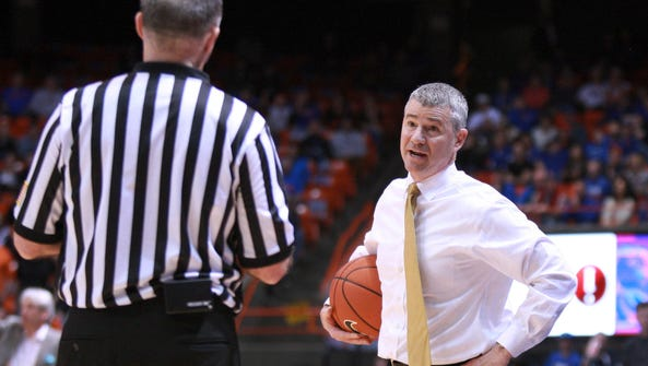 Boise State coach Leon Rice, right, questions a call