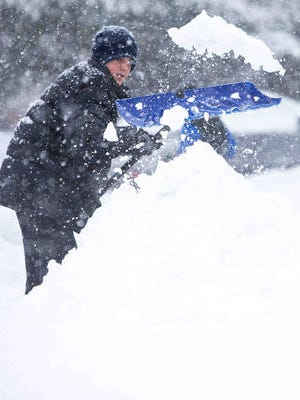 Trevor Kane, 15, has no school but helps clear the snow from his driveway in Hockessin last March.