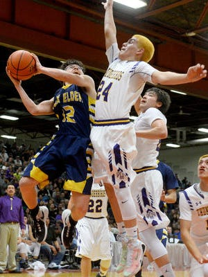 Box Elder's Tanner Parisian attempts a layup as Hays Lodgepole's Frank RunsAbove defends during the Northern C Divisional Basketball Tournament championship game in the Four Seasons Arena, Saturday.