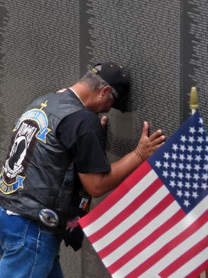 A veterans pays tribute at the Wall South in Pensacola in this file photo.