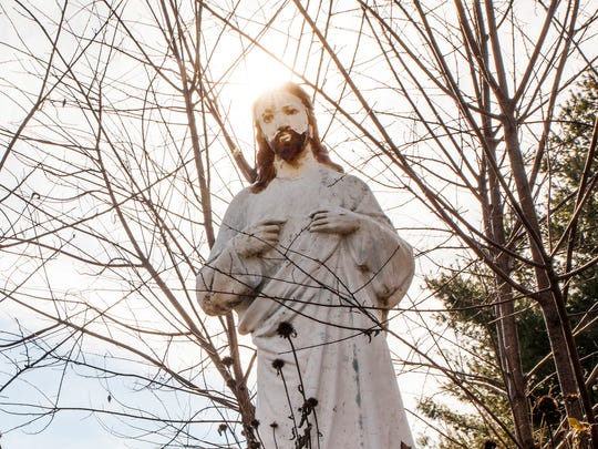 A statue of St. Luke stands outside of the abandoned building where Patti Dean helped found St. Luke's Home, an assisted living facility in Fishersville, with her parents and first husband.