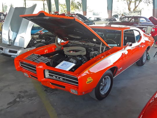 Graham Phillips of Vero Beach took the third-place trophy for Best in Show with his perfectly restored 1969 Pontiac GTO 'Judge.