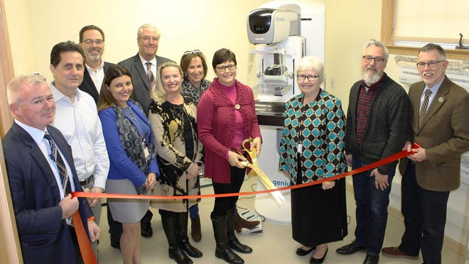 Members of St. Anthony Community Hospital and the Warwick Chamber of Commerce join Mary Juliano, Chair of the Bon Secours Warwick Foundation Board (center holding scissors), additional members of the Bon Secours Warwick Foundation Board, Village of Warwick Mayor Michael Newhard and Warwick Town Supervisor Michael Sweeton to celebrate the new 3D mammography equipment.