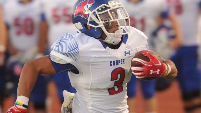 Cooper High School's Noah Garcia carries the ball in the first quarter against Lubbock Monterey on Sept. 27.