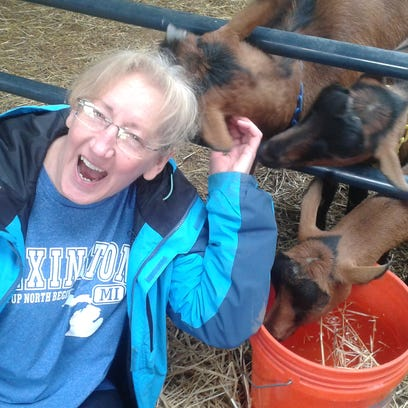 Debra Popp of Highland Township gets friendly with