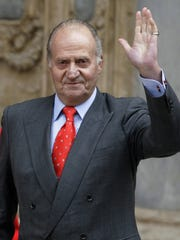 In this file photo from April 12, 2009, King Juan Carlos waves after attending an Easter Mass at the Cathedral of Palma de Mallorca.