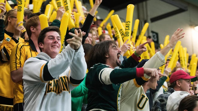 Fans celebrate as the Catamouts score a goal during the men's hockey game between the Michigan Wolverines and the Vermont Catamounts at Gutterson Field House on Friday night October 28, 2016 in Burlington. (BRIAN JENKINS/for the FREE PRESS)