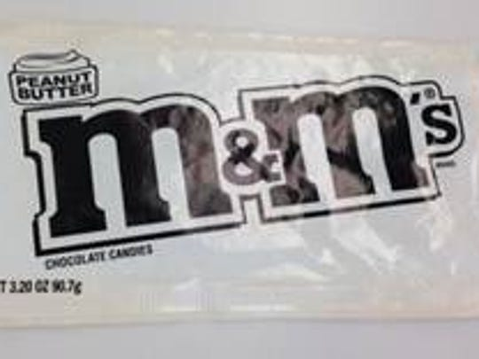 The potential inside package of a M&M's milk chocolate theater box which may contain a bag of Peanut Butter M&M's.
