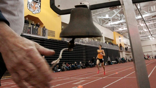 McQuaid's Nick Ciolkows is alone in front as he takes the bell signaling the final lap on his way to winning the 3,200-meter Class A race at the Section V Class A/B Winter Track and Field Championships Thursday.