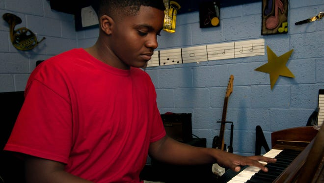 """Franklin """"Kinte"""" Gilbert, winner of the Boys and Girls Club of America New Mexico Youth of the Year Award, plays the piano at the Las Cruces Boys and Girls Club, June 15, 2016."""