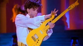 Prince playing his Yellow Cloud electric guitar.