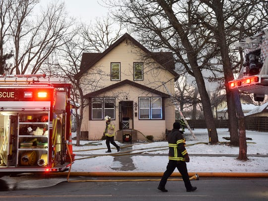 Firefighters respond to a report of a fire in the upper story of a house at 908 7th Avenue North Tuesday, Dec. 26, in St. Cloud.